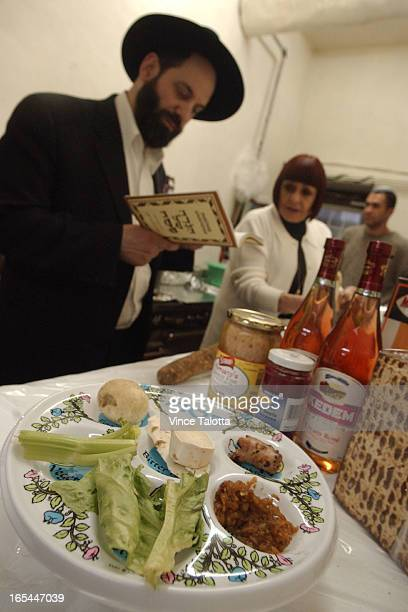 SEDAR 4/16/03 Rabbi Shmuel Spero reads passages from the Passover Haggadah to inspire kitchen staff at the Anshe Minsk SynagogueThe meals begins with...