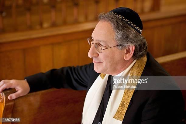 Rabbi sitting in synagogue pew