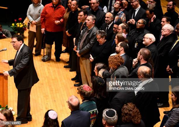 A Rabbi speaks during a vigil to remember the victims of the shooting at the Tree of Life synagogue the day before at the Allegheny County Soldiers...