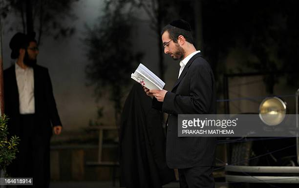 A Rabbi student who traveled from the USA to conduct passover seder ceremonies in Nepal reads as he prepares for this evening event on March 25 2013...