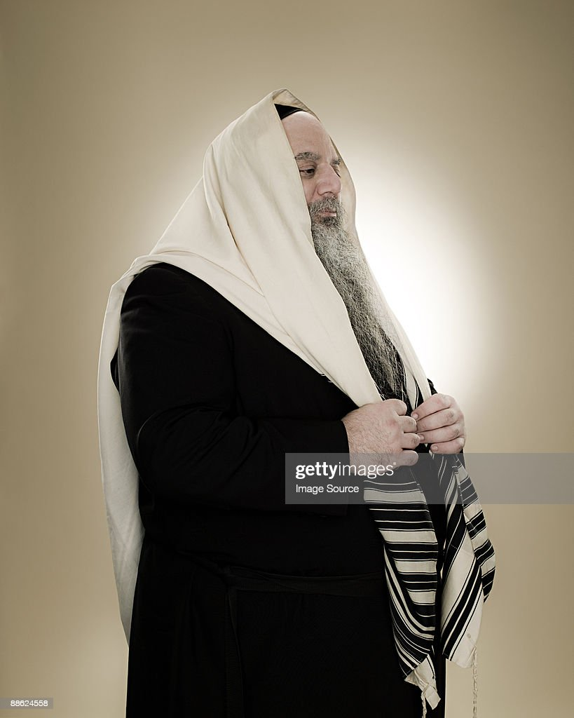 A rabbi wearing a prayer shawl : Stock Photo