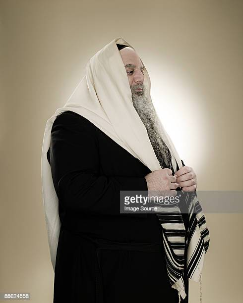a rabbi wearing a prayer shawl - jewish prayer shawl ストックフォトと画像