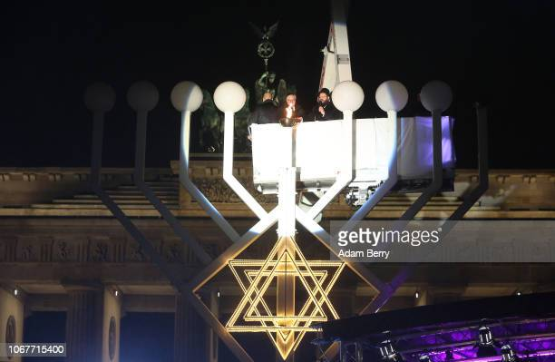 Rabbi Yehuda Teichtal and German President FrankWalter Steinmeier light Europe's largest menorah during a public lighting ceremony on the first night...