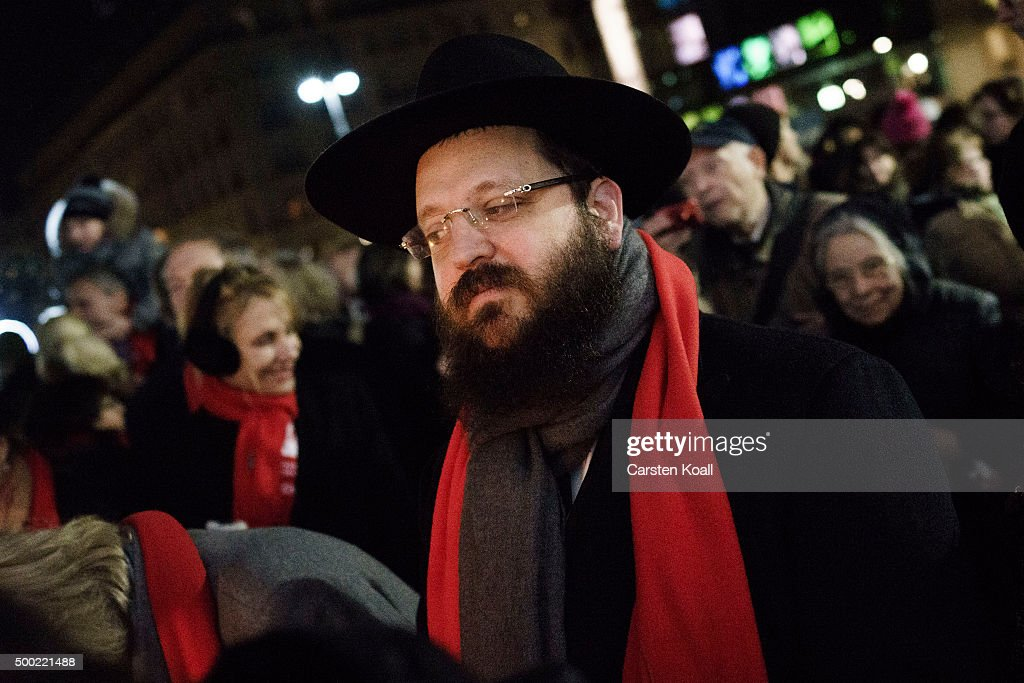 Rabbi Yehuda Teichtal attends the ceremony of the Hanukkah menorah lighting at a public Menorah ceremony near the Brandenburg Gate on December 6, 2015 in Berlin, Germany. The annual events are part of a worldwide Hanukkah campaign set into motion by the Lubavitcher Rebbe Rabbi Menachem M. Schneerson, of righteous memory.