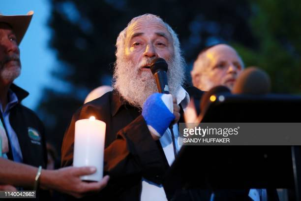 Rabbi Yisroel Goldstein speaks to community members and congregants about the shooting at the Chabad of Poway Synagogue during a candlelight vigil...