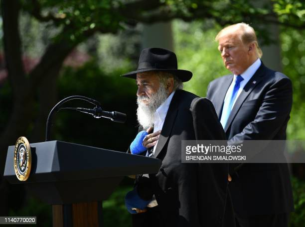 Rabbi Yisroel Goldstein with US President Donald speaks during the National Day of Prayer Service in the Rose Garden of the White House in Washington...