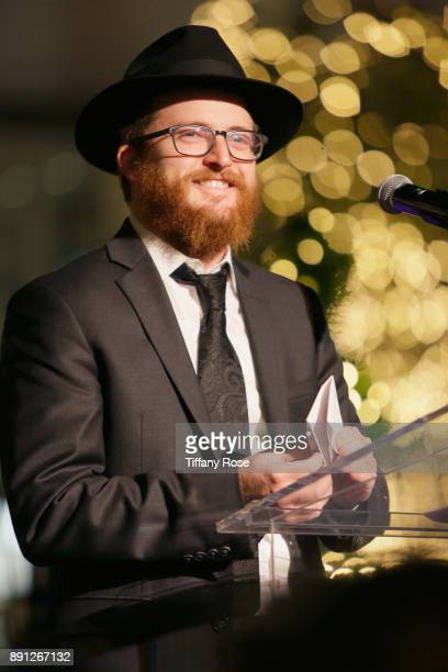 Rabbi Zamy Fogelman speaks onstage at the Village Synagogue and Emmanuelle Chriqui Host Menorah Lighting Ceremony at The Grove on December 12 2017 in...