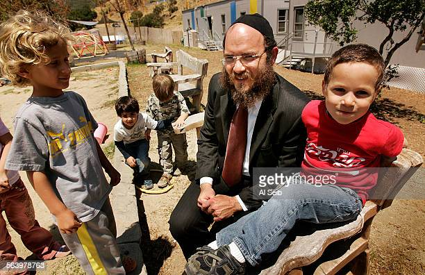 Rabbi Zushe Cunin Executive Director of Chabad of Pacific Palisades with his own son Zalmen Cunin 4–years–old and Ely Dickson Isaac Alkin and Jason...