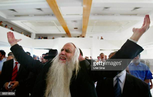 Rabbis and former Jewish settlers pray for the last time in a synagogue in what used to be the Jewish settlement of Neve Dekalim September 8 2005 in...