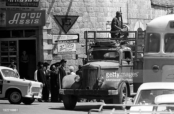 Rabbis looking at an Israeli soldier on a truck in the Six Days War June 1967