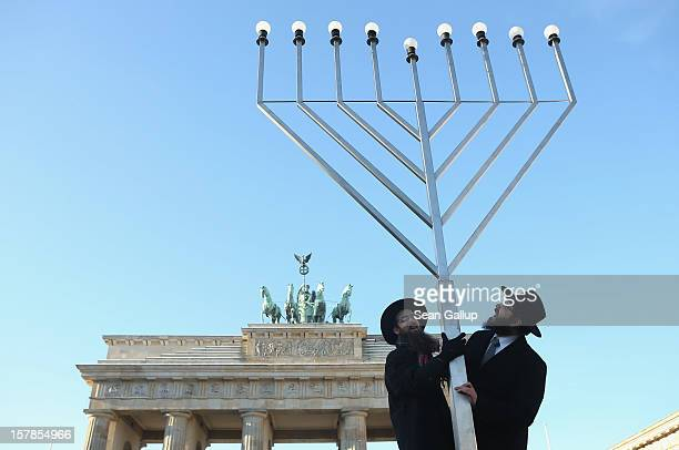 Rabbis Schmuel Segal and Yehuda Teichtal of the Berlin Orthodox Jewish Chabad community chants a blessing after raising a menorah in front of the...