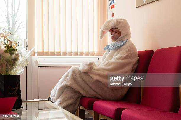rabbit in waiting room - easter bunny costume stock pictures, royalty-free photos & images