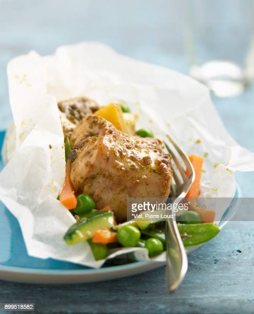 Rabbit with coriander,lemons and vegetables cooked in wax paper