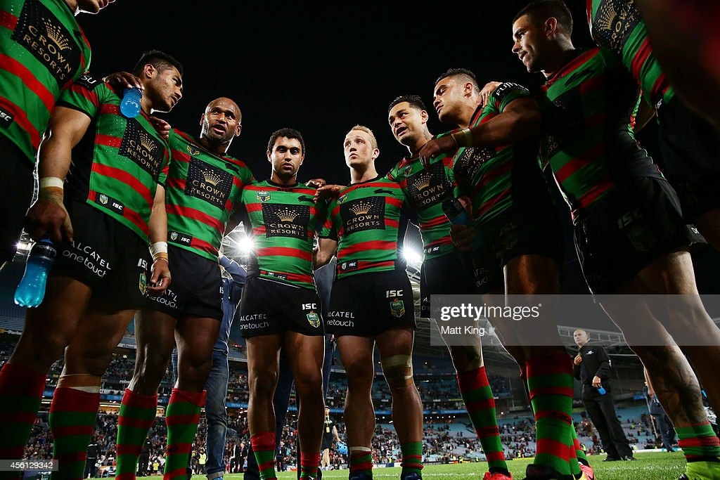 Rabbitohs captain John Sutton speaks to his players in a huddle after the First Preliminary Final match between the South Sydney Rabbitohs and the Sydney Roosters at ANZ Stadium on September 26, 2014 in Sydney, Australia.