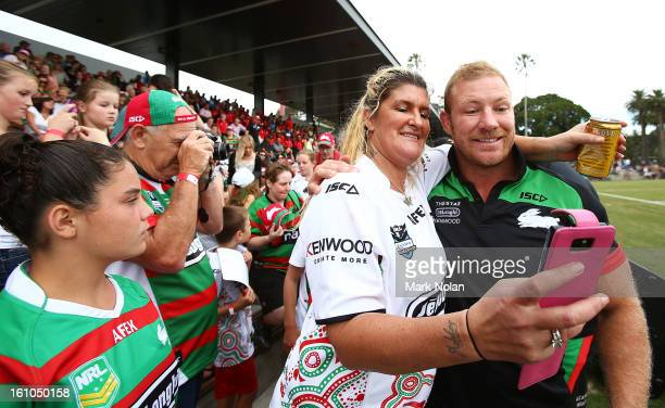 Rabbitohs captain Michael Crocker poses with a fan for a photo before the NRL trial match between the South Sydney Rabbitohs and the Papua New Guinea...