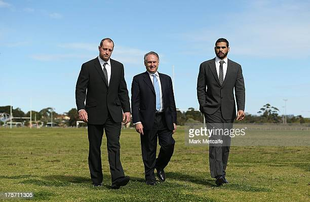 Rabbitohs coach Michael Maguire Federal Minister for Sport Senator Don Farrell and Greg Inglis pose during a South Sydney Rabbitohs NRL media...