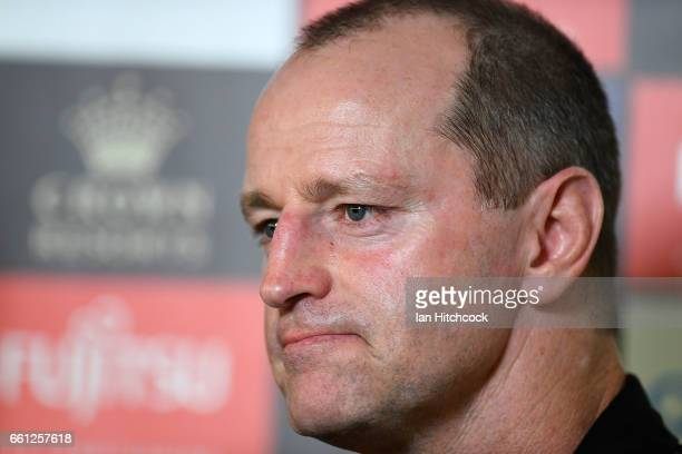 Rabbitohs coach Michael Maguire looks on during a television interview before the start of the round five NRL match between the North Queensland...