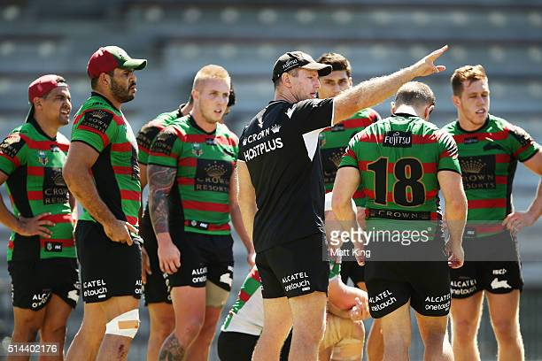 Rabbitohs coach Michael Maguire speaks to players during a South Sydney Rabbitohs NRL training session at Redfern Oval on March 9 2016 in Sydney...