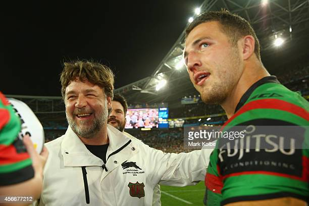 Rabbitohs coach Russell Crowe speaks to Sam Burgess of the Rabbitohs after victory during the 2014 NRL Grand Final match between the South Sydney...