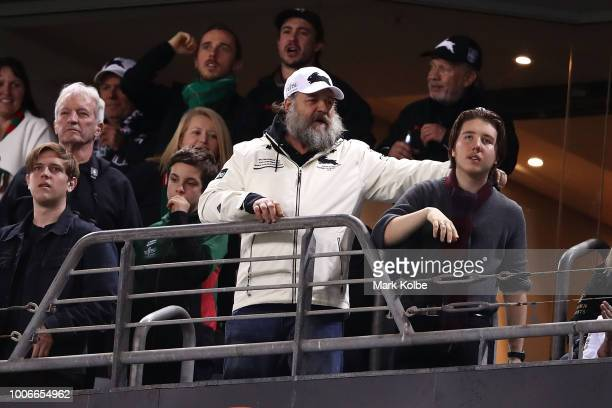 Rabbitohs coowner Russell Crowe celebrates as he watches on during the round 20 NRL match between the South Sydney Rabbitohs and the Parramatta Eels...