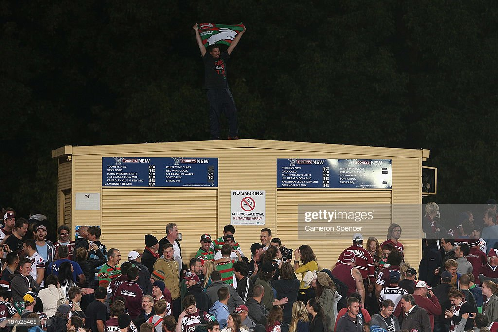A Rabbitohs fan celebrates after his team won the round seven NRL match between the Manly Sea Eagles and the South Sydney Rabbitohs at Brookvale Oval on April 26, 2013 in Sydney, Australia.