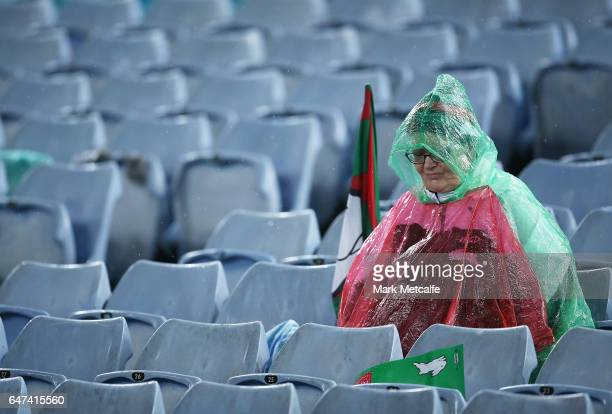 Rabbitohs fan looks dejected during the round one NRL match between the South Sydney Rabbitohs and the Wests Tigers at ANZ Stadium on March 3 2017 in...