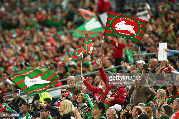 Rabbitohs fans show their colours during the round 21 NRL match between the South Sydney Rabbitohs and the Penrith Panthers at ANZ Stadium on August...