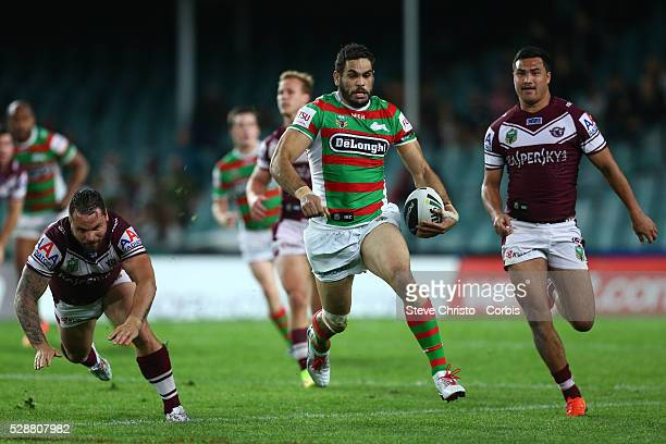 Rabbitohs Greg Inglis pushes off Manly's Anthony Watmough and makes a break up field during the match at Allianz Stadium. Sydney, Australia. Friday...