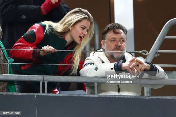 Rabbitohs owner Russell Crowe watches the action from a box during the round 25 NRL match between the South Sydney Rabbitohs and the Wests Tigers at...