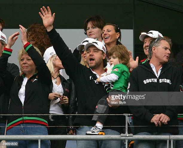 Rabbitohs part owner Russell Crowe celebrates with his son Charlie after the Rabbitohs victory over the Eels during the round two NRL match between...