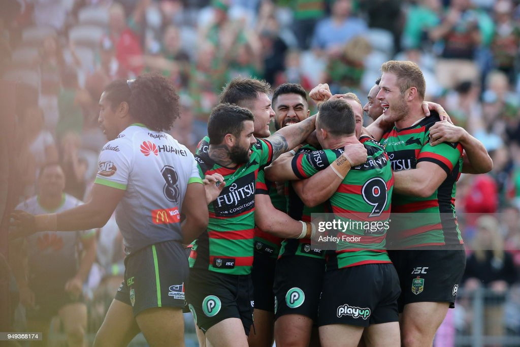 Rabbitohs players celebrate a try during the round seven NRL match between the South Sydney Rabbitohs and the Canberra Raiders at Central Coast Stadium on April 21, 2018 in Gosford, Australia.