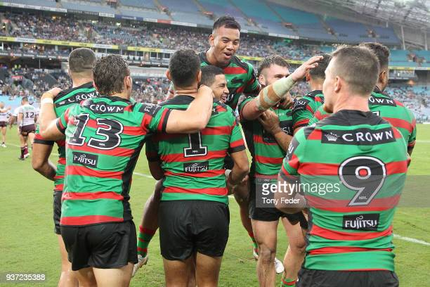 Rabbitohs players celebrate a try during the round three NRL match between the South Sydney Rabbitohs and the Manly Sea Eagles at ANZ Stadium on...