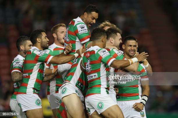 Rabbitohs players celebrate a try from Cody Walker during the round nine NRL match between the Newcastle Knights and the South Sydney Rabbitohs at...