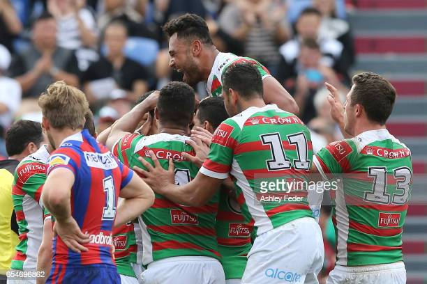 Rabbitohs players celebrte during the round three NRL match between the Newcastle Knights and the South Sydney Rabbitohs at McDonald Jones Stadium on...