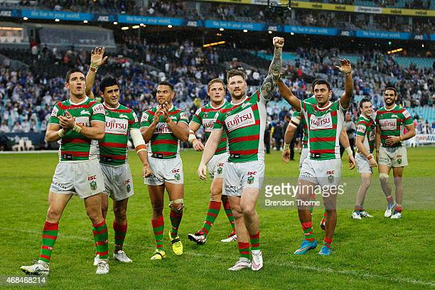 Rabbitohs players gestures towards their fans after victory over the Bulldogs during the round five NRL match between the Canterbury Bulldogs and the...