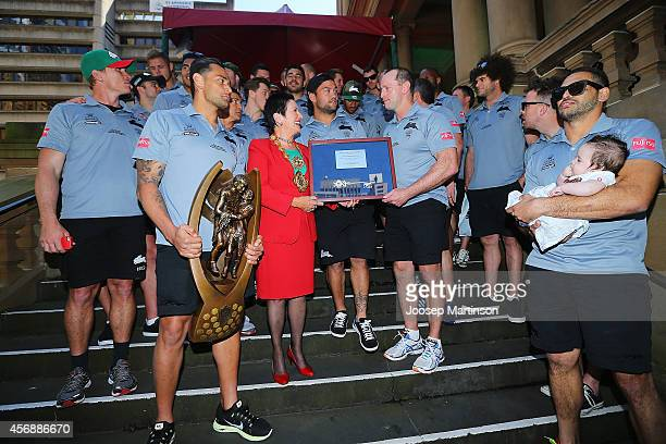 Rabbitohs players pose with the key to the city during a South Sydney Rabbitohs NRL Grand Final celebration at Sydney Town Hall on October 9 2014 in...