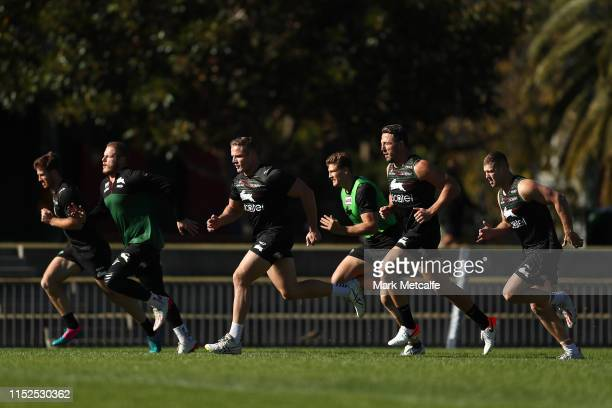 Rabbitohs players run during a South Sydney Rabbitohs NRL training session at Redfern Oval on May 30, 2019 in Sydney, Australia.