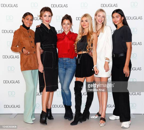 Rabea Schif, Nadine Warmuth, Anna Julia Kapfelsperger, Pamela Reif, Leonie Hanne and Wana Limar attend the re-opening of the Douglas flagship store...