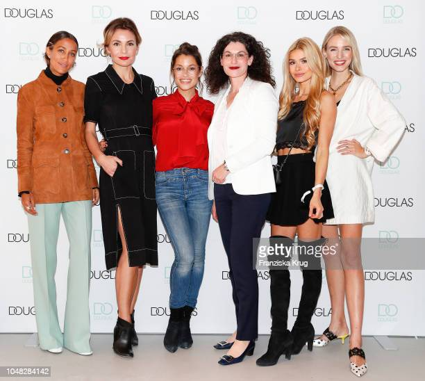 Rabea Schif Nadine Warmuth Anna Julia Kapfelsperger Tina Mueller Pamela Reif and Leonie Hanne attend the reopening of the Douglas flagship store on...