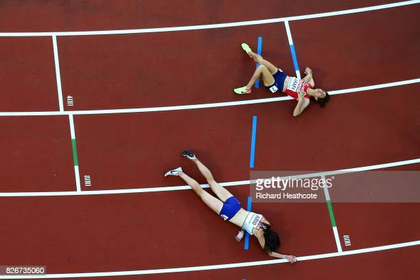 Rabebe Arafi of Morrocco and Jessica Judd of Great Britain lay on the track following the Women's 1500 metres semi final during day two of the 16th...