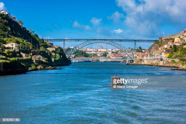 Rabelo Boat approaching the Dom Luis I Bridge in Porto Portugal