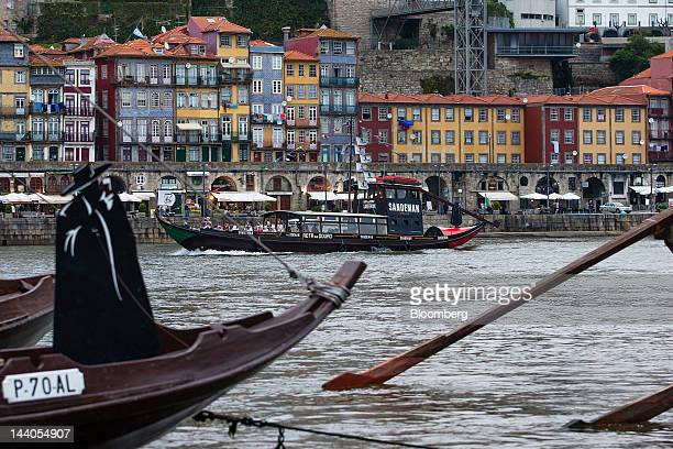 A Rabelo boat navigates the Douro river in Oporto Portugal on Tuesday May 8 2012 Portuguese Prime Minister Pedro Passos Coelho said 2012 is the most...