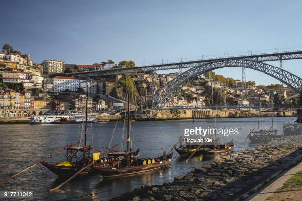 Rabelo boats along Douro River with Dom Luis I bridge, Portugal