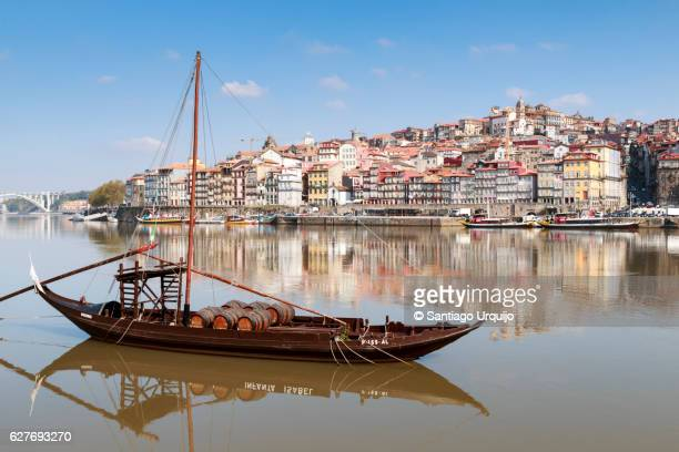 rabelo boats moored in douro river - douro river stock photos and pictures