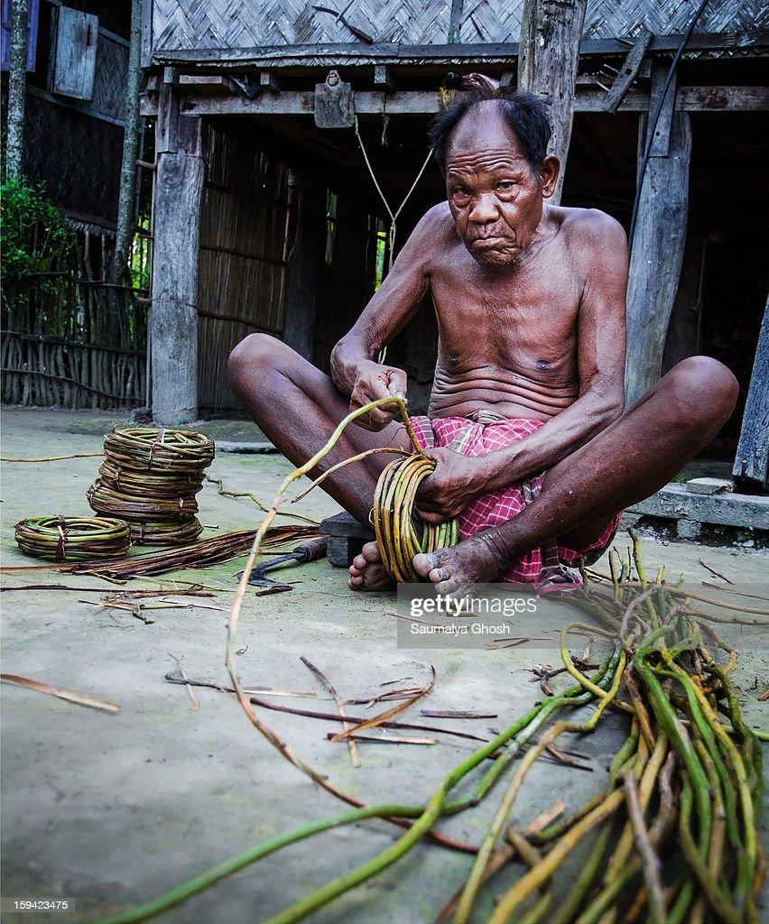 Rava Tribal life - Man at work : News Photo