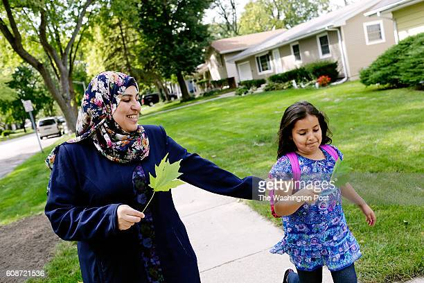 Rabia Ali left plays with leaves with her daughter Boshra right after picking her up from school on Wednesday September 14 2016 in Aurora IL One of...