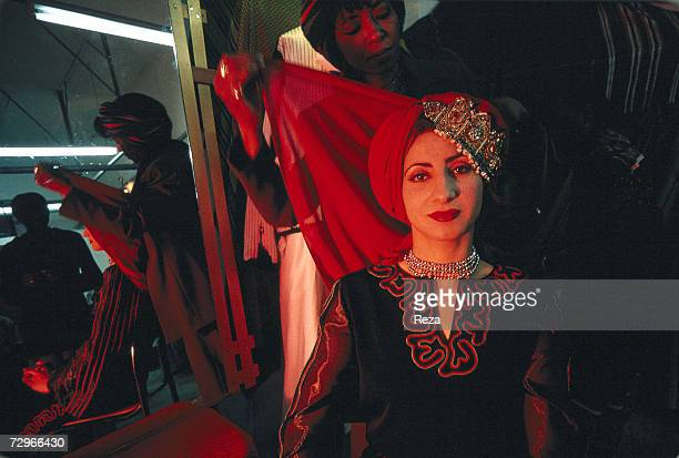 Rabia Ben Barka a fashion designer dresses up a model in her workshop on April 2000 in Tripoli Libya
