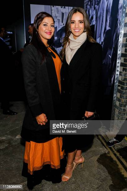 Rabia Clarke and Vanessa Ponce attend a private view of Mandela The Official Exhibition at 26 Leake Street on February 07 2019 in London England