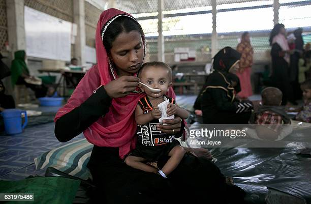 Rabia feeds her 15 month old son at the Action Contre La Faim center for the severely malnourished January 18 2017 in Coxs Bazar Bangladesh One week...