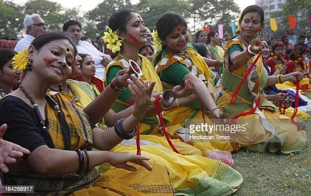 Rabindra Bharti University's students performing at 'Basanta Utsav' cultural Programme at BTRoad campus on March 21 2013 in Kolkata India Holi by the...